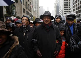 U.S. Rep. Bobby Rush and the Rev. Jesse Jackson link arms as they march with demonstrators protesting the shooting of Laquan McDonald along the Magnificent Mile in Chicago on Nov. 27, 2015.Joshua Lott/Getty Images