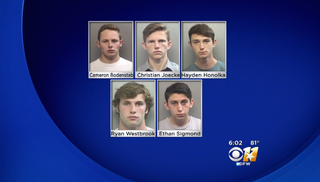 Five students at Arlington High School in Texas are facing a felony charge after allegedly spray-painting racist and transphobic messages on the outside of a rival high school.CBS DFW screenshot