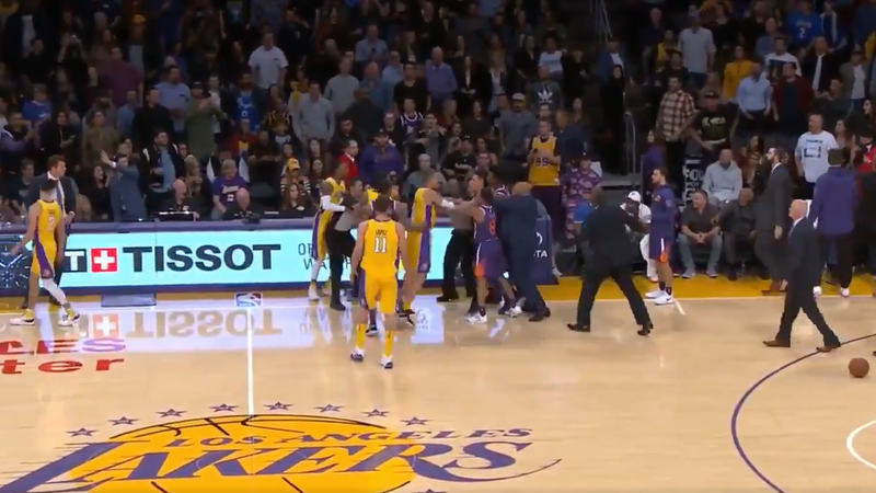 Lonzo Ball rushing to head coach Luke Walton's aid. Image via YouTube