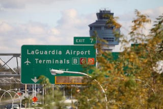 A view of a LaGuardia Airport highway sign in New York City on Oct. 31, 2012MEHDI TAAMALLAH/AFP/Getty Images