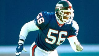 Hall of Fame linebacker Lawrence Taylor takes a hit.