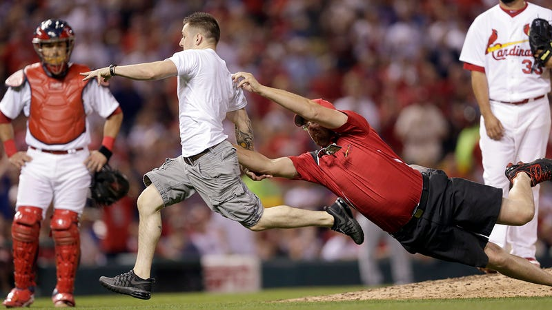 Illustration for article titled Idiot On The Field Races Past Security, Somersaults Onto Home Plate
