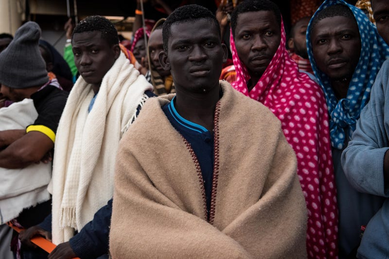 Refugees and migrants wait on deck of the Spanish NGO Proactiva Open Arms rescue vessel Golfo Azzurro to disembark after being rescued off the Libyan coast north of Sabratha, Libya, on Feb. 19, 2017. (David Ramos/Getty Images)