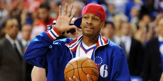 Allen Iverson delivers the game ball at a Philly 76ers game in May 2012. (Drew Hallowell/Getty Images)