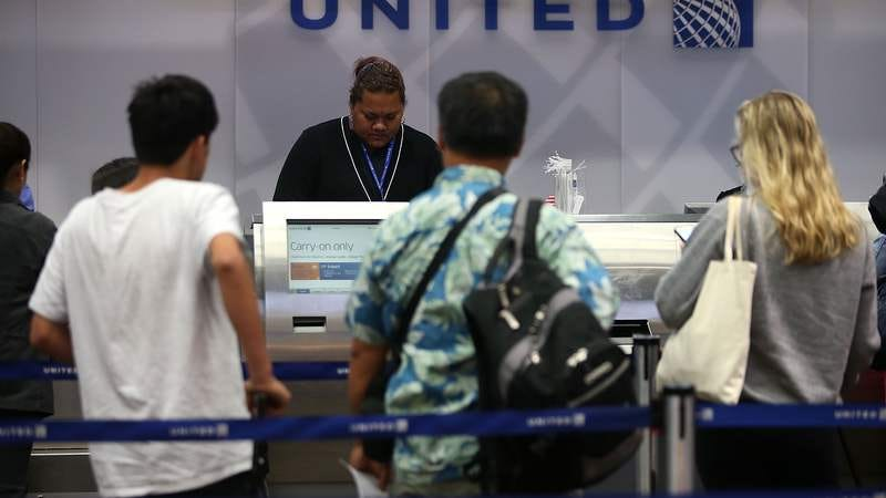 At United, that human touch begins at the counter and doesn't end until you're forcibly removed from your seat. (Photo: Justin Sullivan/Getty)