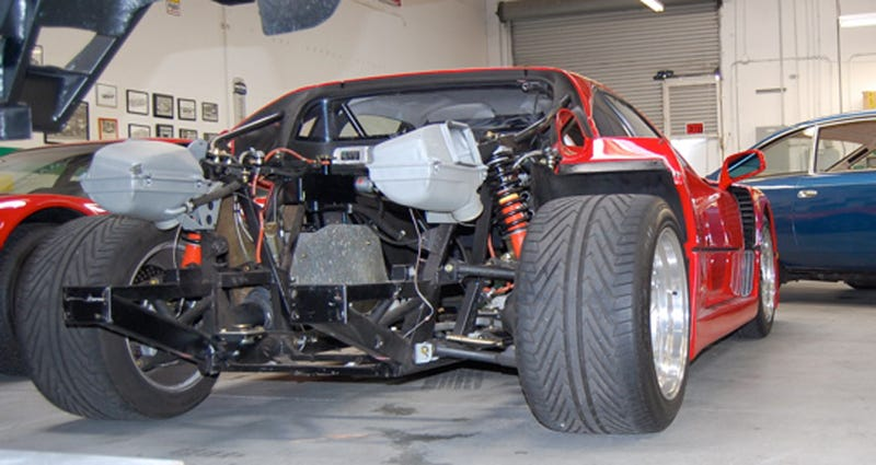 tearing down the engine of a ferrari f