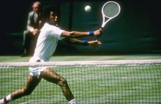 Arthur Ashe runs down a ball during a 1975 match at Wimbledon in London. Forty years ago, he became the first black man to win the tournament.Getty Images