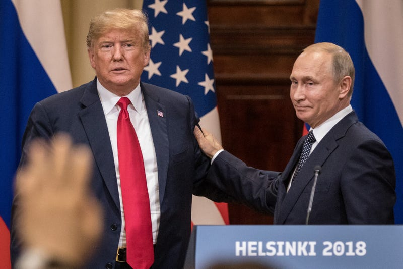 President Donald Trump and Russian President Vladimir Putin shake hands during a joint press conference after their summit on July 16, 2018 in Helsinki, Finland.