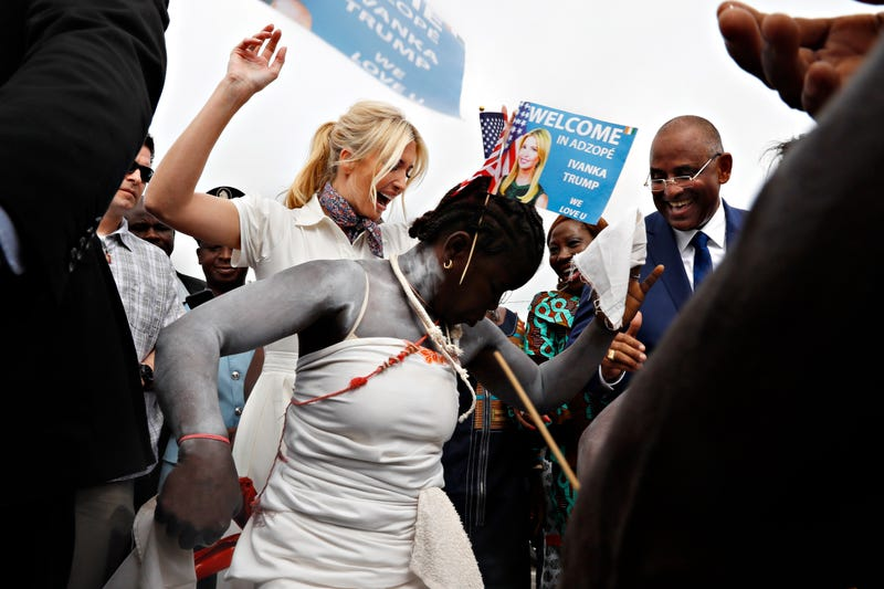 White House senior adviser Ivanka Trump dances with traditional dancers as she is welcomed by local people on arrival to Adzope, Ivory Coast, Wednesday April 17, 2019, where she will tour Cayat, a cocoa and coffee cooperative.