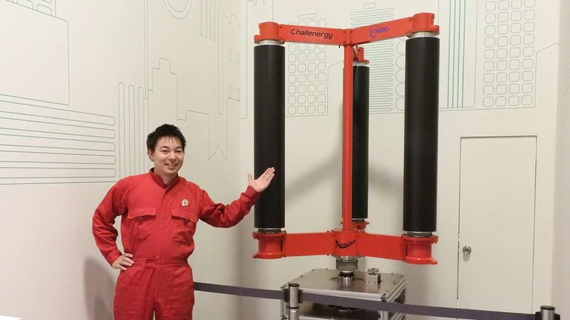 Shimizu shows off a model of his typhoon turbine. (Image: Challenergy)