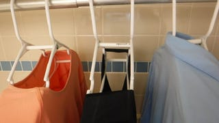 "Illustration for article titled Hang Dry Your Shirts Faster With These DIY ""Space Hangers"""
