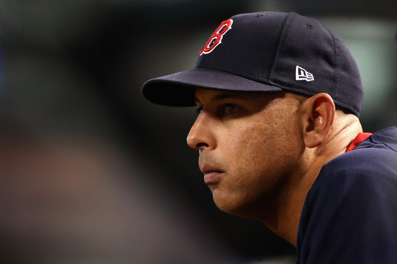 Manager Alex Cora of the Boston Red Sox watches from the dugout during the fifth inning of the MLB game against the Arizona Diamondbacks at Chase Field on April 5, 2019 in Phoenix, Arizona.