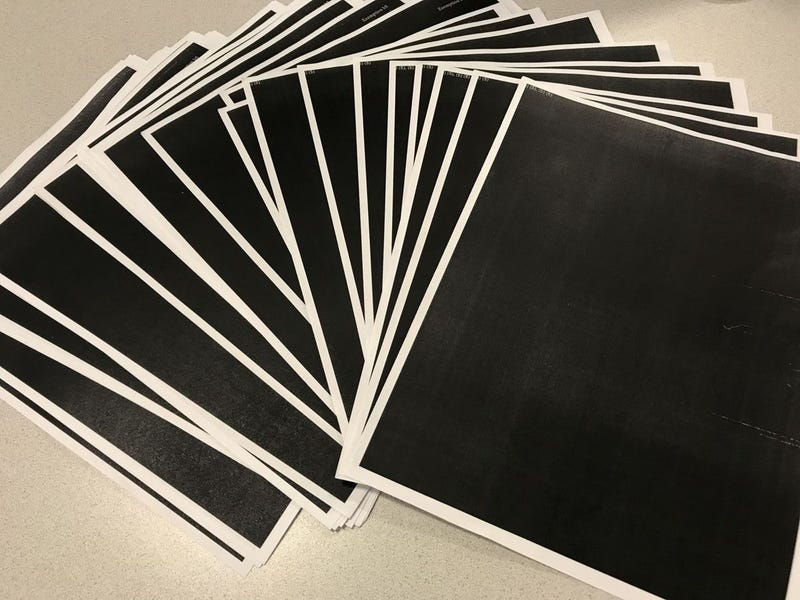 Chuck Raasch of the St. Louis Post-Dispatch took this photo of the documents he received from the U.S. Department of Justice Office of Community Oriented Policing Services in response to a Freedom of Information Act request. The documents were totally redacted. (Chuck Raasch/St. Louis Post-Dispatch)