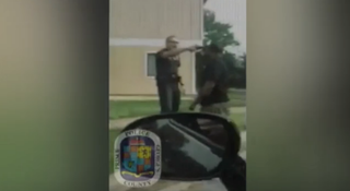 Officer Jenchesky Santiago holding a gun to William Cunningham's headPrince George's County Police Department/YouTube screenshot