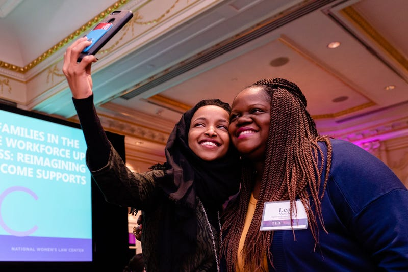 Representative Ilhan Omar and activist Lea Webb pose for a selfie after Omar's keynote at the Young Elected Officials Women's Conference in New York on Saturday, Feb. 2, 2019.