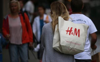 A shopper carries a bag from H&M on Aug. 13, 2014, in San Francisco.Justin Sullivan/Getty Images