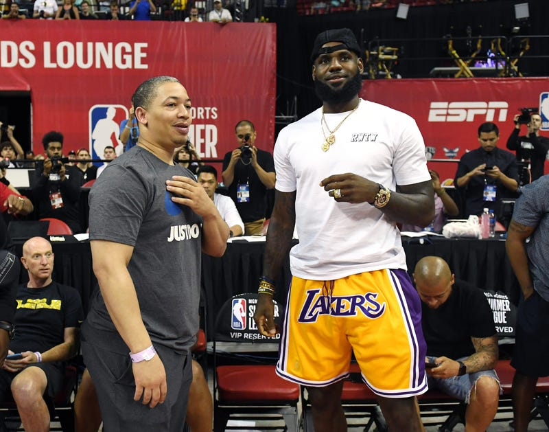 Tyronn Lue, left, of the Cleveland Cavaliers talks with LeBron James of the Los Angeles Lakers after a quarterfinal game of the 2018 NBA Summer League between the Lakers and the Detroit Pistons at the Thomas & Mack Center on July 15, 2018 in Las Vegas, Nevada.