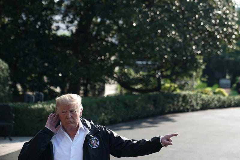 President Donald Trump speaks to members of the media prior to a Marine One departure at the South Lawn of the White House September 19, 2018 in Washington, DC. President Trump is traveling to North and South Carolinas to visit the area that was affected by Hurricane Florence.