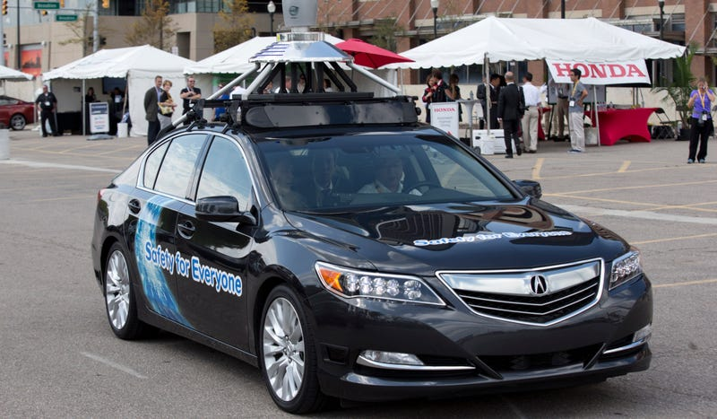 An Acura RLX sedan, a prototype car, is shown during a demonstration in Detroit, Tuesday, Sept. 9, 2014. (AP Photo/Paul Sancya)