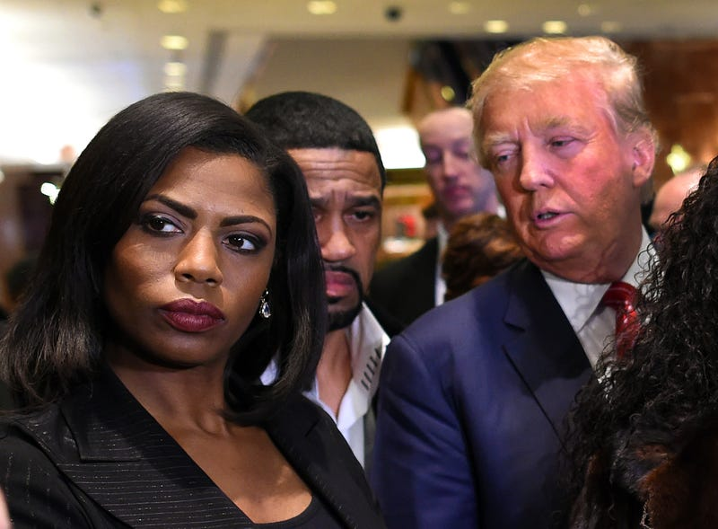 Omarosa Manigault appears alongside presumed GOP presidential nominee Donald Trump during a press conference in New York City on Nov. 30, 2015.TIMOTHY A. CLARY/AFP/Getty Images