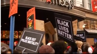 Protesters for justice in Ferguson, Mo., and worker rights demonstrate outside Macy's in New York City Nov. 28, 2014.Yahoo screenshot