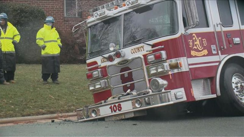 Illustration for article titled Fat-Ass Fire Truck Sinks Into Pavement
