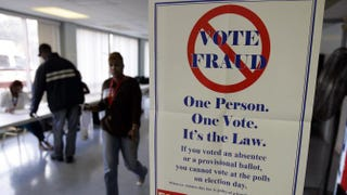 A voter-fraud sign is seen at Lupica Towers Nov. 4, 2008, in Cleveland.J.D. Pooley/Getty Images