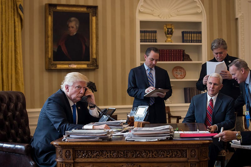 President Donald Trump speaks on the phone with Russian President Vladimir Putin in the Oval Office of the White House in Washington, D.C., on  Jan. 28, 2017. Also pictured: Then-White House chief of staff Reince Priebus, Vice President Mike Pence (seated), White House chief strategist  Steve Bannon and then-press secretary Sean Spicer. (Drew Angerer/Getty Images)
