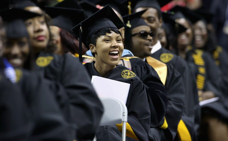 Graduates cheer as first lady Michelle Obama delivers the commencement speech during the Bowie State University graduation ceremony at the Comcast Center on the campus of the University of Maryland on May 17, 2013, in College Park, Md.Chip Somodevilla/Getty Images