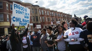 People protest April 28, 2015, near a CVS pharmacy that was set on fire the day before during unrest after the funeral of Freddie Gray in Baltimore.Andrew Burton/Getty Images
