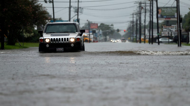 Cars driving through floodwaters in Lake Charles, Louisiana during Hurricane Harvey aftermath. Photo credit: AP Photo/Gerald Herbert