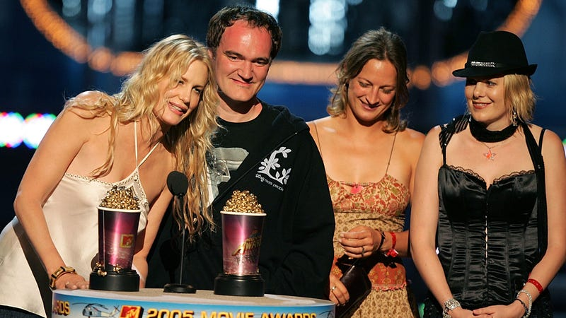 Daryl Hannah with Director Quentin Tarantino accepting the award for Best Fight Scene for Kill Bill. Vol. 2. Hannah claims that she told Tarantino about Weinstein, and he did nothing. Image via Getty.