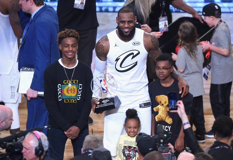 LeBron James Jr., LeBron James #23, Zhuri James and Bryce Maximus James pose for a photo with the All-Star Game MVP trophy during the NBA All-Star Game 2018 at Staples Center on Feb. 18, 2018, in Los Angeles.