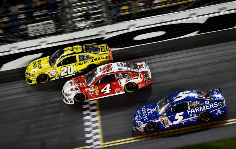 Drivers cross the finish line of the NASCAR Sprint Cup Series Budweiser Duel 1 race at Daytona International Speedway on Feb. 20, 2014, in Daytona Beach, Fla.Jared C. Tilton/Getty Images
