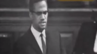 Malcolm X speaks during a debate at the Oxford Union at Oxford University in 1964.YouTube Screenshot