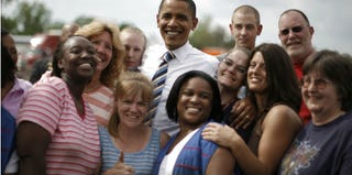 Then-Sen. Barack Obama poses for a picture with a mixed group of unionized workers. (Reuters/Jason Reed)