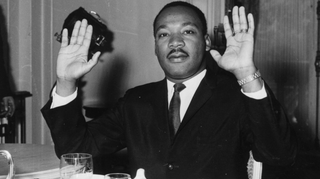 Martin Luther King Jr. holding his hands up in a restaurantTwitter