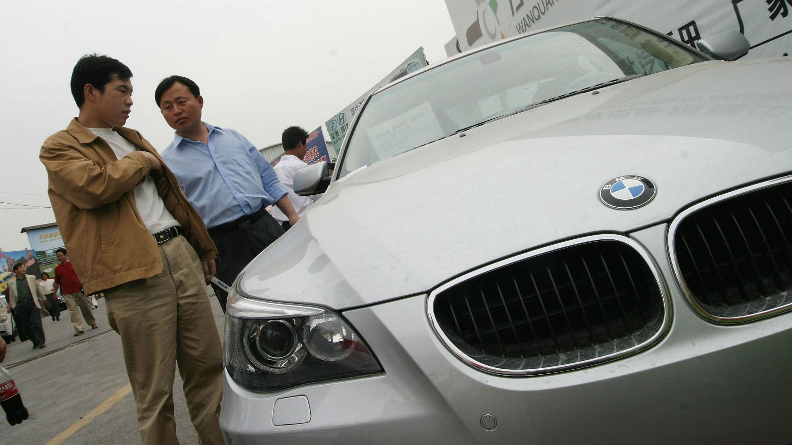 Car Salesman Salary: BMW Will Pay $820 Million To Bailout Chinese Car Dealers