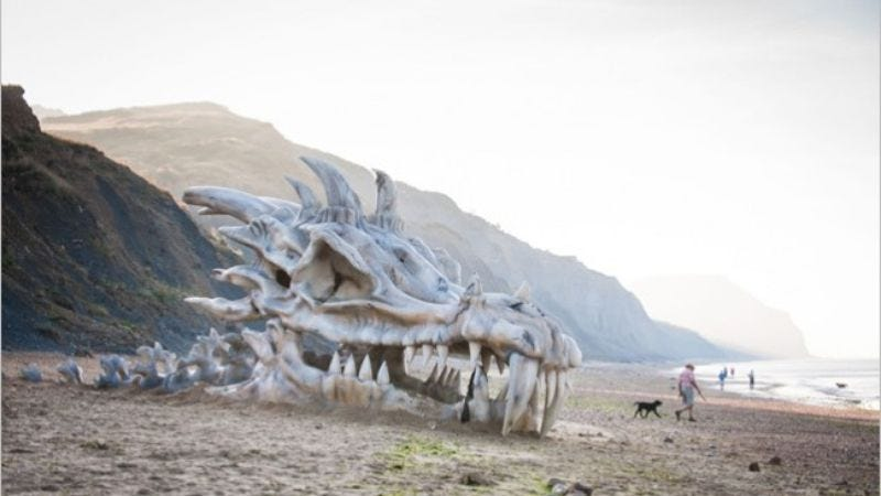 Illustration for article titled Game Of Thrones advertised with a giant dragon head on a beach