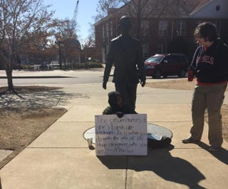 Correl Hoyle sitting in front of the James Meredith statue on the campus of the University of Mississippi Tyler Carter