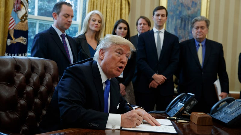 President Donald Trump signs the executive order for the Keystone XL Pipeline. Photo: AP