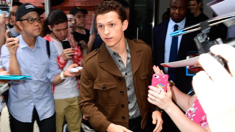 """Illustration for article titled Real-life superhero Tom Holland saves distressed fan from aggressive """"graphers"""""""
