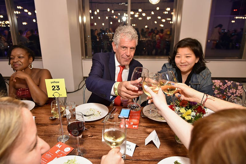 Chef Anthony Bourdain (center) dines with guests at the (RED) Supper hosted by Mario Batali with Anthony Bourdain on June 2, 2016, in New York City.