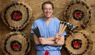 Illustration for article titled Meet the Knife-Throwing Boob Surgeon Who Set a World Record