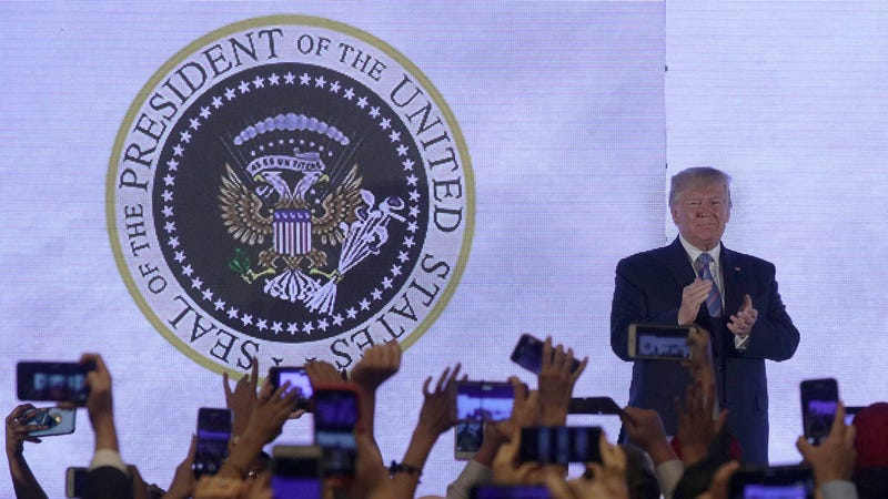 Illustration for article titled Trump Gives Speech in Front of Altered Presidential Seal Featuring Golf Clubs and '45 Is a Puppet'