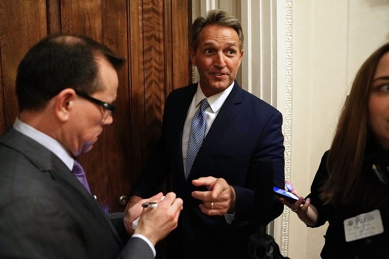 Sen. Jeff Flake talks briefly with reporters after leaving the Senate Chamber at the U.S. Capitol on Oct. 24, 2017, in Washington, D.C. (Chip Somodevilla/Getty Images)