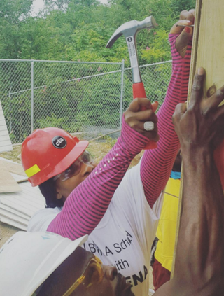 Serena Williams uses a hammer as she helps build a primary school in Jamaica.Instagram