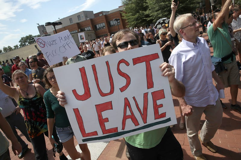 Counter protesters shout after Jason Kessler, an organizer of 'Unite the Right' rally, fled after trying to speak outside the Charlottesville City Hall on August 13, 2017 in Charlottesville, Virginia. The city of Charlottesville remains on edge following violence at a 'Unite the Right' rally held by white nationalists, neo-Nazis and members of the 'alt-right'