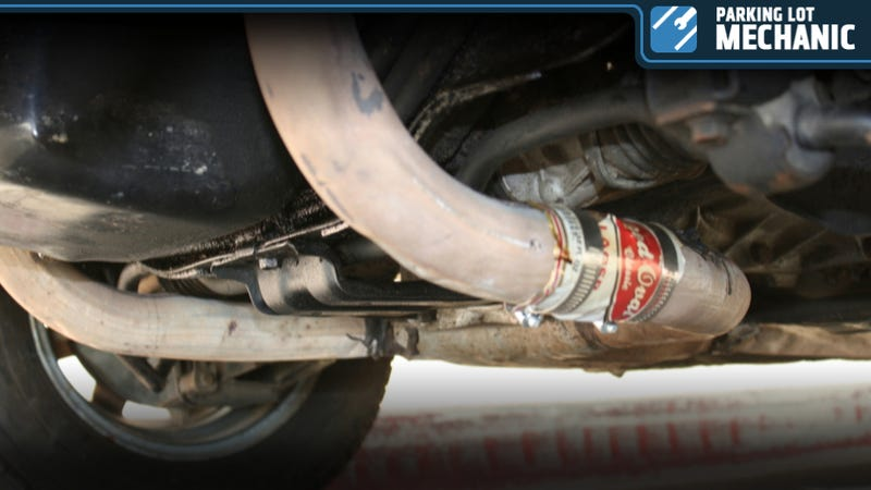 Illustration for article titled How To Fix Your Exhaust With An Empty Beer Can