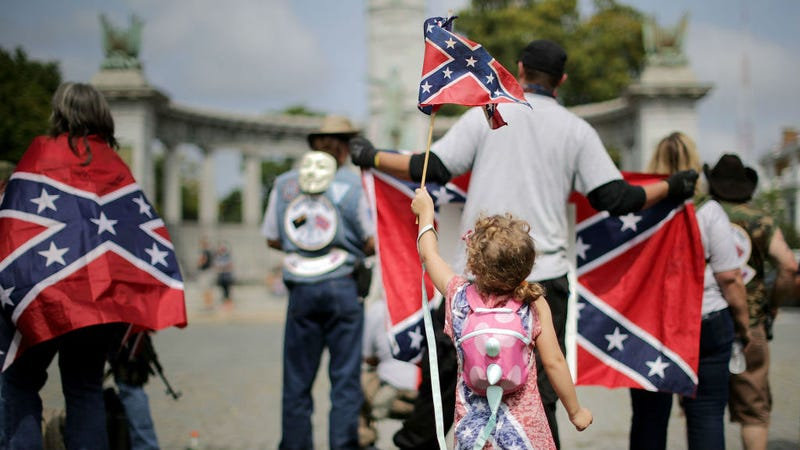 Supporters of Confederate heritage groups rally Aug. 19, 2018, in Richmond, Va., to protest plans to remove a statue honoring Jefferson Davis, president of the confederacy during the Civil War.